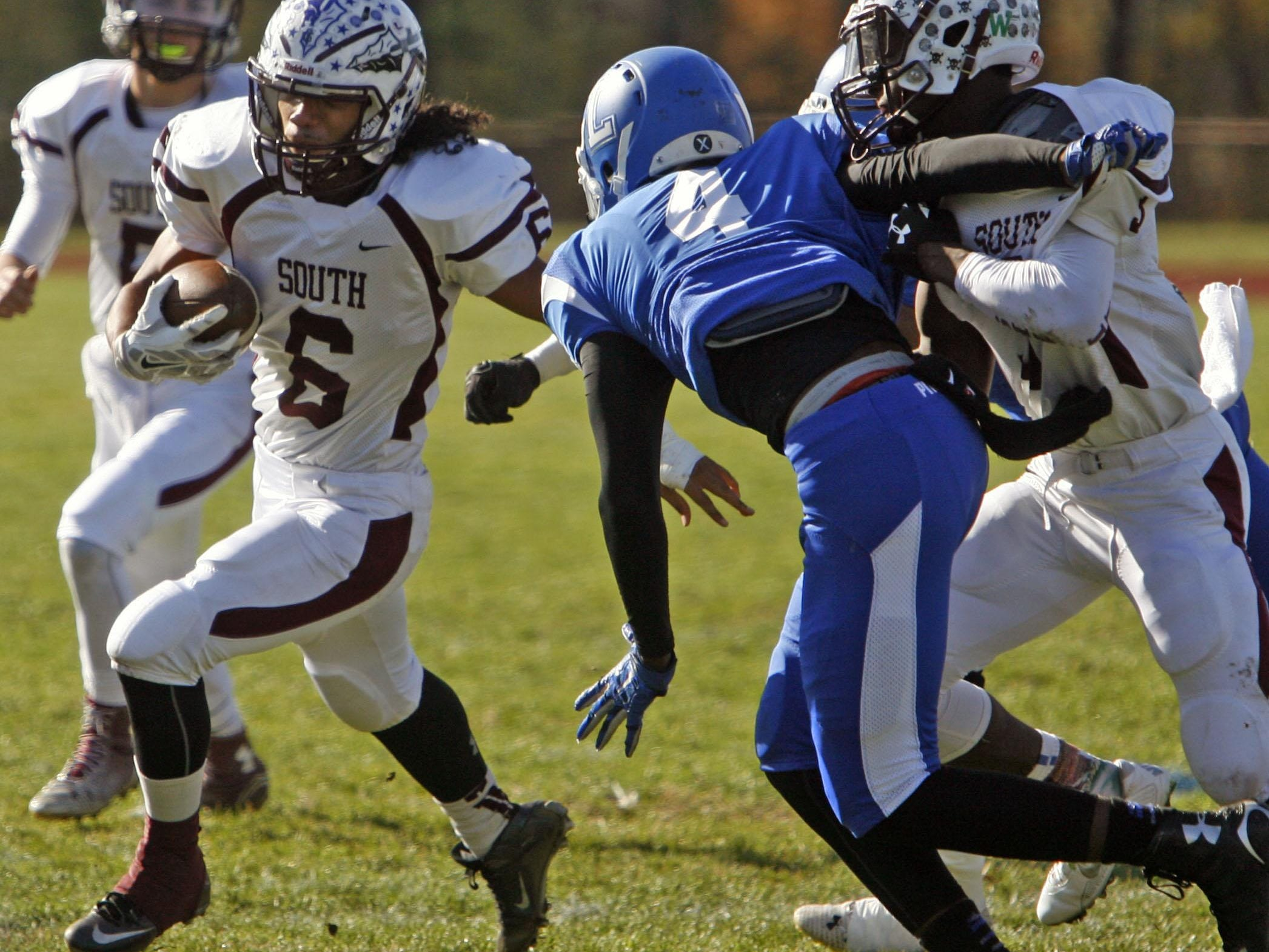 Toms River South's Malcolm Gillespie (6), left, gains yardage against Lakewood at Lakewood High School Nov. 26, 2015. Photo by Vincent DiSalvio / Special to The ASBURY PARK PRESS