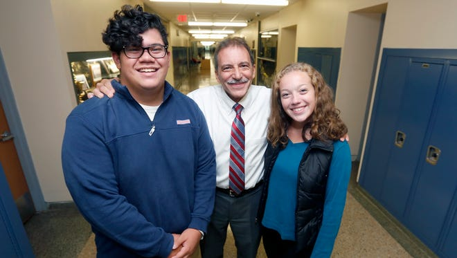 Carlos Prats, 17, left, school principal Vincent Carella, and Allison Hansen, 16, in the hallways of Nanuet High School on Friday, September 30, 2016.ÊNanuet Senior High School is being recognized as an ÒExemplary High Performing SchoolÓ being awarded National Blue Ribbon School for 2016.Ê