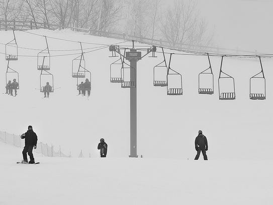 Skiers approach the bottom of a hill recently at Powder