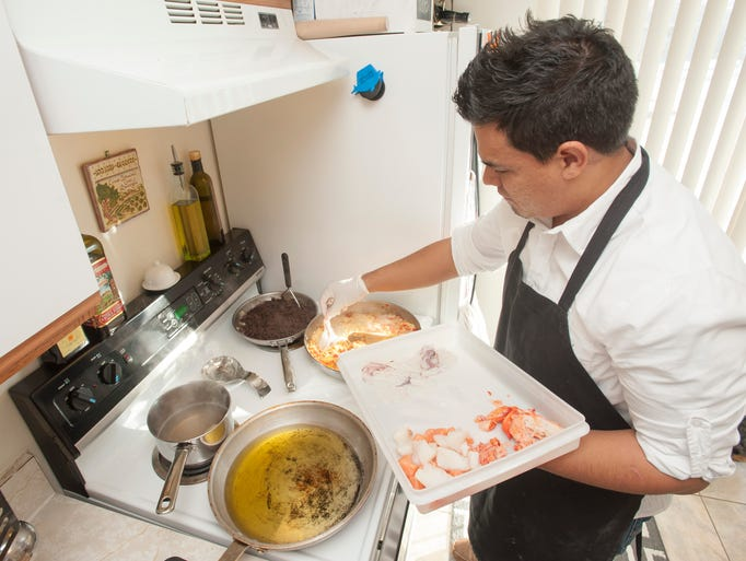 Luis Antopia, executive chef of Cafe Cortina, add the