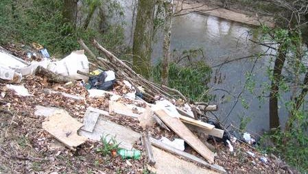 Trash clean up of Smith Mill Creek, which feeds into the pictured French Broad River, is a focus of a GreenWorks service day.