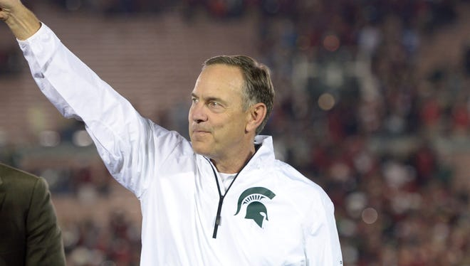 Michigan State Spartans coach Mark Dantonio poses with the Leishman Trophy at the 100th Rose Bowl against the Stanford Cardinal. Michigan State defeated Stanford 24-20. Dantonio and his assistants received a pay raise from MSU Tuesday.