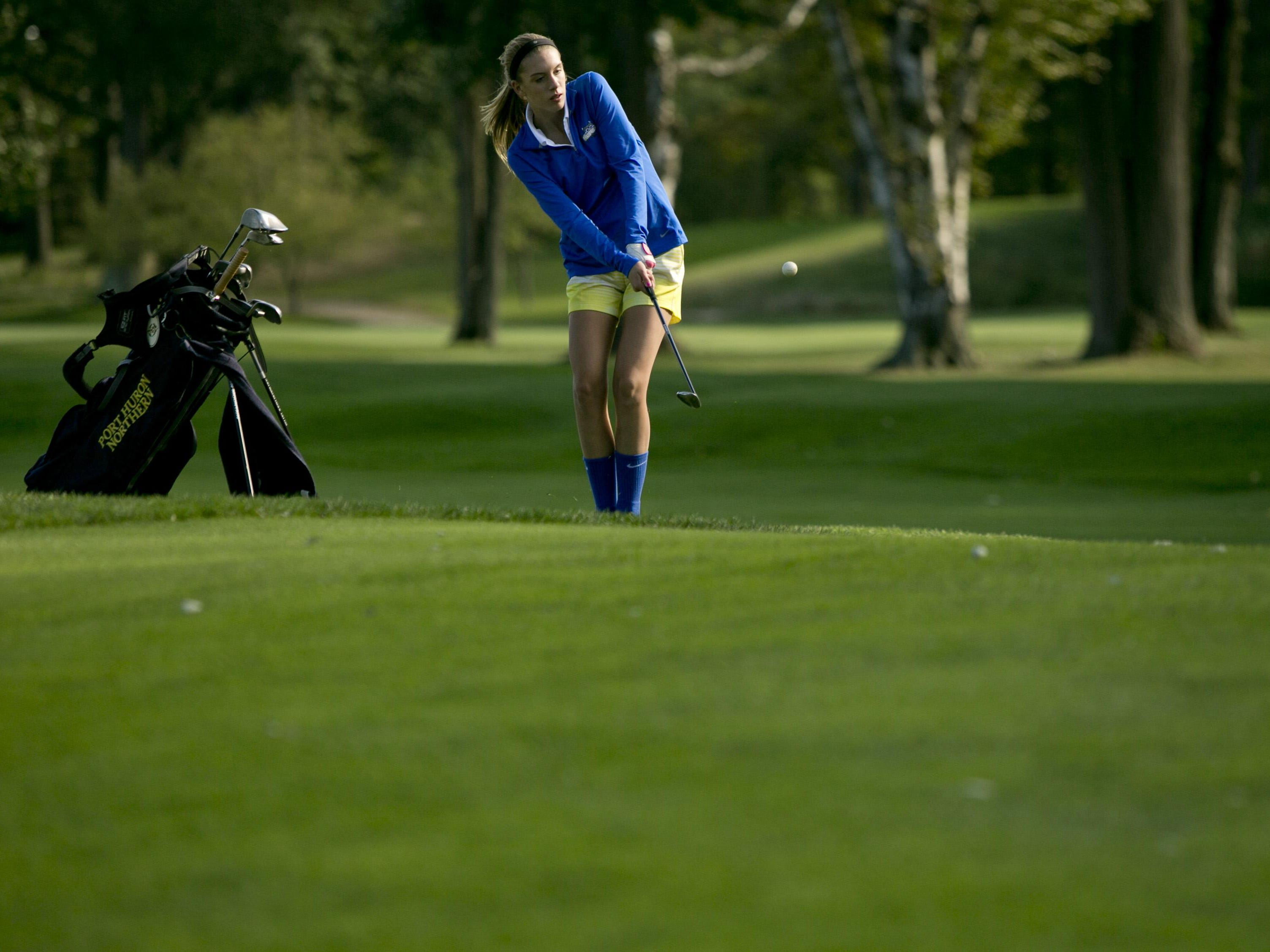 Port Huron Northern freshman Delaney Ward takes a shot Wednesday, September 30, 2015 at the Port Huron Golf Club.