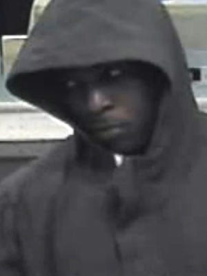 Police released video footage Wednesday of two hooded men who robbed a McLean Avenue bank earlier this week. A $1,500 reward is being offered for information leading to their arrests.