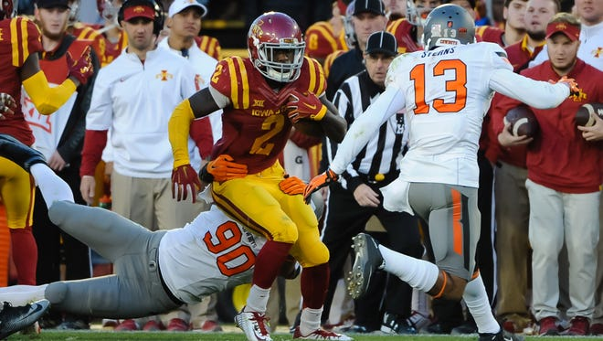 Iowa State Cyclones running back Mike Warren (2) gains yards against the Oklahoma State Cowboys  at Jack Trice Stadium. Oklahoma State defeated Iowa State 35-31.