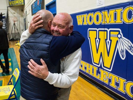 Former Wi-Hi basketball player Scot Dailey hugs coach