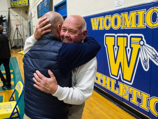 Former Wi-Hi basketball player Scot Dailey hugs coach Butch Waller after his 800th career win on Thursday, Feb. 1, 2018.
