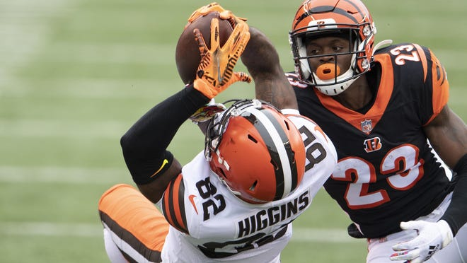 Cincinnati cornerback Darius Phillips (23) attempts to break up a pass to Cleveland wide receiver Rashard Higgins on Sunday. Higgins should be added to fantasy squads after Odell Beckham Jr.'s injury.