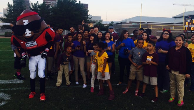 ASU Prep students of all ages and the AZ Super Bowl Host Committee mascot, Spike turn up the energy on their new football field, September 27, 2014.