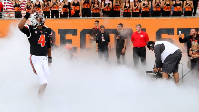 Oregon State quarterback Seth Collins (4) takes the field against Weber State during the first half at Reser Stadium, Friday, September 4, 2015, in Corvallis, Ore. The Beavers won the game 26-7.