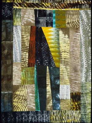 This quilt was created by Cynthia Corbin, the featured artist of the Stitches in Bloom quilt show at The Oregon Garden.