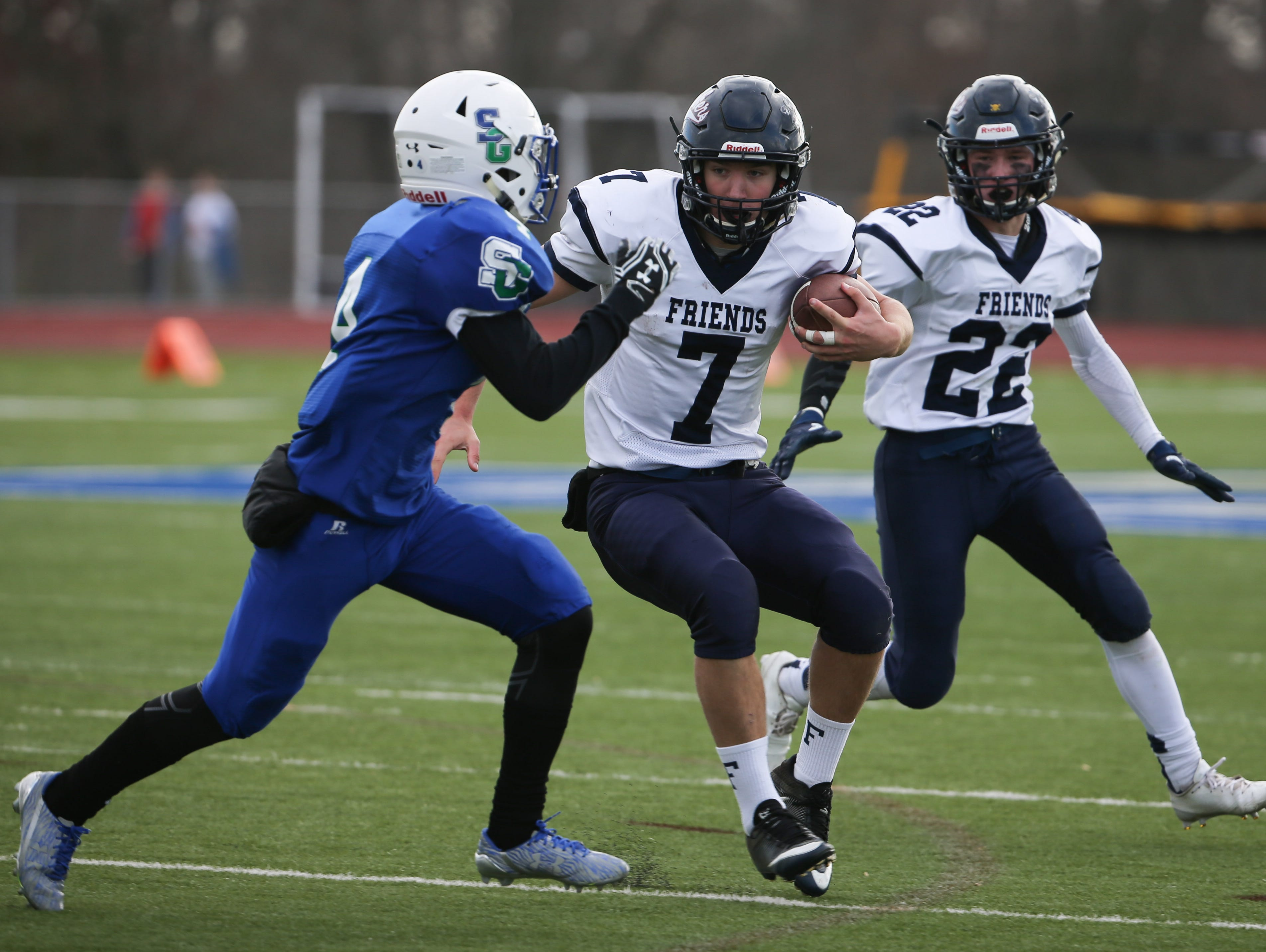 Friends quarterback Justin Beneck runs the ball in the fourth quarter. Wilmington Friends advances to the DIAA Division II state finals with a 20-6 win over St. Georges Saturday.