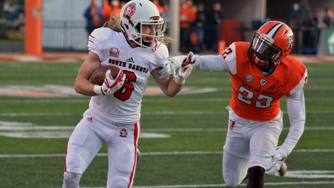 USD wide receiver Kody Case runs downfield against Bowling Green on Saturday in Bowling Green, Ohio.
