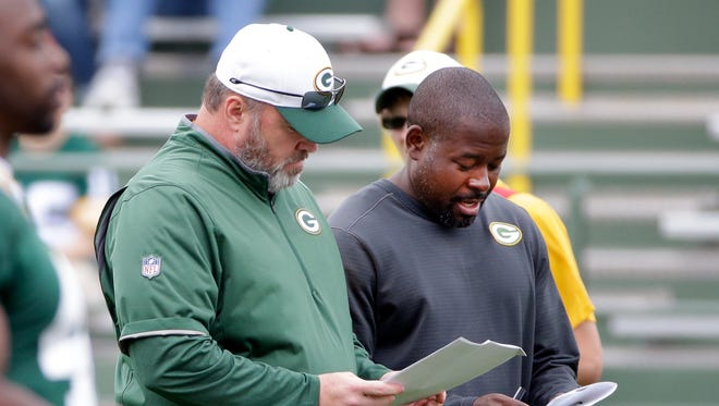 Green Bay Packers head coach Mike McCarthy, left, and secondary coach Joe Whitt confer during minicamp at Ray Nitschke Field June 16, 2016.