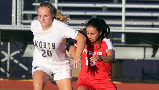 Clarkstown North's Jane Mulvey (20) and North Rockland's Madison Rodriguez (19) battle for control of the ball during girls soccer game at Clarkstown North high school in New City Sept. 26, 2017. North Rockland defeats Clarkstown North 3-2.