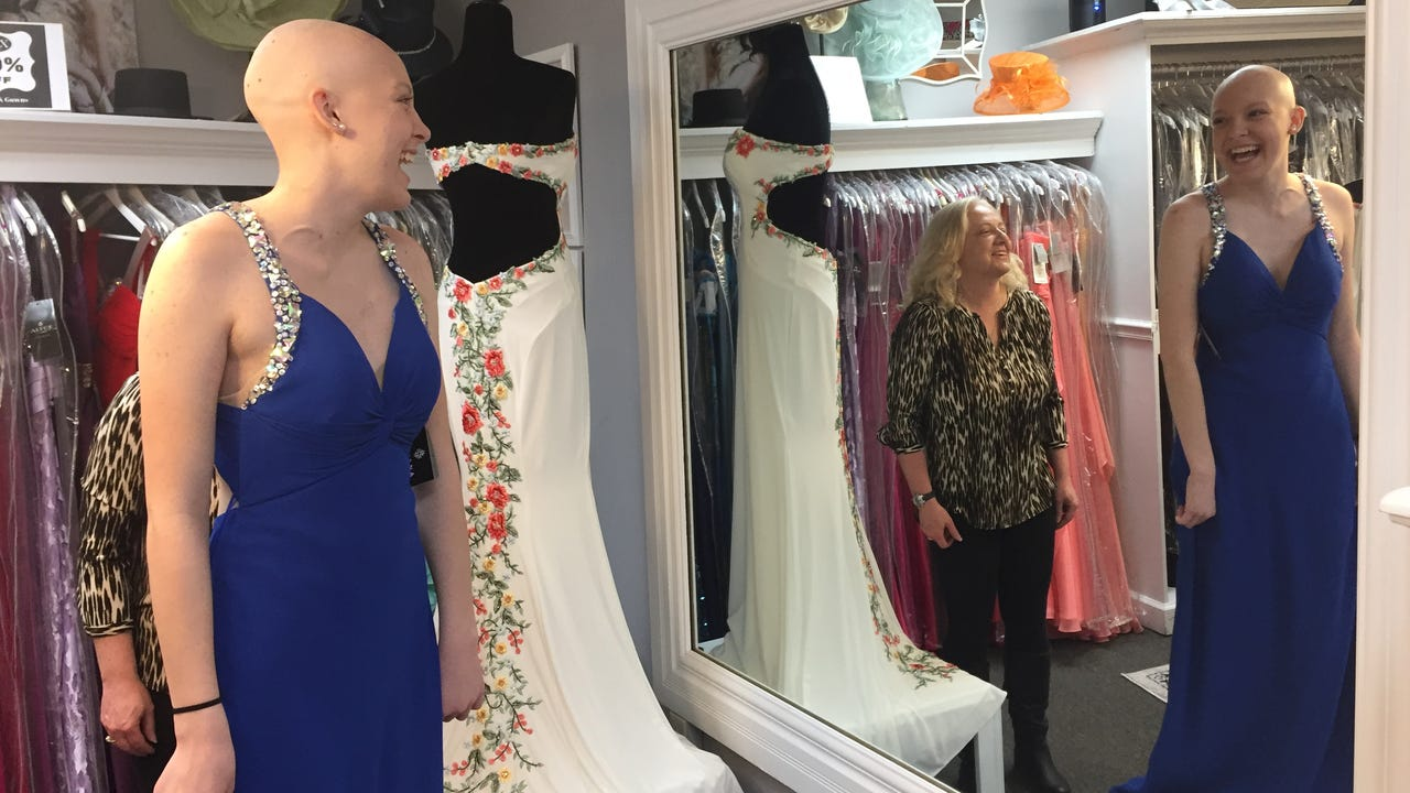 Alyssa White, a Fairfield High School student battling Hodgkin's lymphoma, visited LUX Boutique in Westminster, where she was allowed to pick out a prom dress for free.