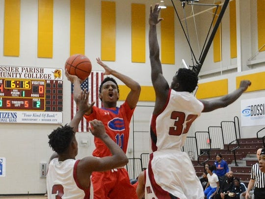 Jacob Jennings goes up for two points against Minden Saturday in the Paul Millsap Classic.