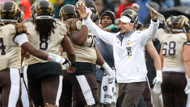 Western Michigan football coach P.J. Fleck celebrates with his team during the third quarter against the Toledo Rockets.
