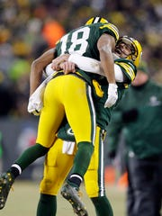 Green Bay Packers quarterback Aaron Rodgers (12) hugs Green Bay Packers wide receiver Randall Cobb (18) after a Hail Mary touchdown pass at the end of the second quarter during the wild-card playoff football game against the New York Giants at Lambeau Field, Sunday, Jan. 8, 2016 in Green Bay,