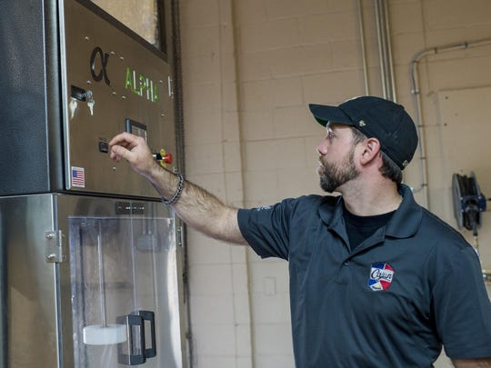 James Lutgring, operations manager and head brewer at Cajun Brewing, explains the operation of a beer keg washer at the new brewery in Lafayette, La., Tuesday, August 25, 2015.
