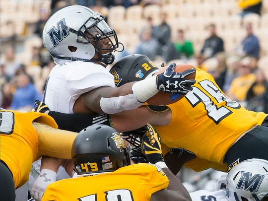 Monmouth's Devell Jones leaps over the pile to try and break the plane of the goal line as he lost the ball during the first half during the first half of the Big South Conference game against Kennesaw State, Saturday Nov. 18, 2017.
