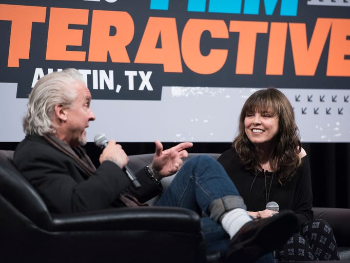 Neil Giraldo (L) and Pat Benatar talk with USA TODAY