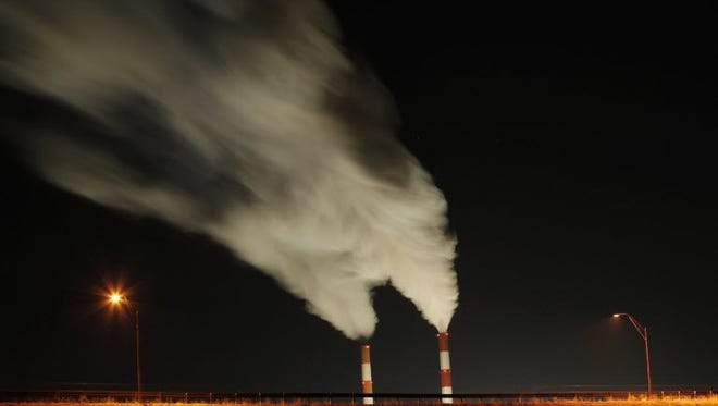 In this Jan. 19, 2012, file photo time exposure image smoke rises from the stacks of the La Cygne Generating Station coal-fired power plant in La Cygne, Kan.