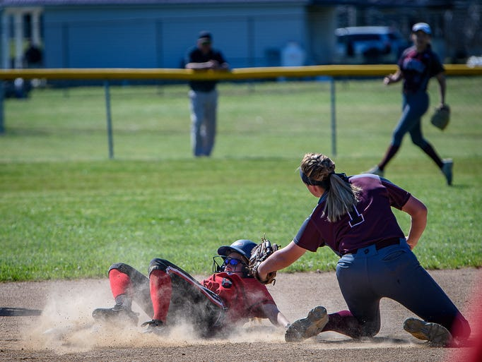 Arcadia's Haley McDaniel slides into second on a close