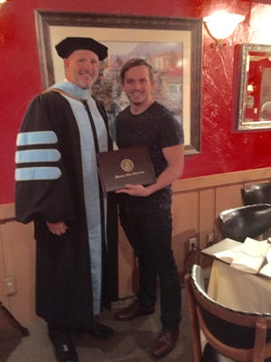 Robert Hornberger, assistant vice president of MSU's enrollment services, surprised Josh Cron Friday night by showing up to dinner with Cron's diploma. Cron missed graduation last month because he suffered a stroke moments before he was to walk across the stage.