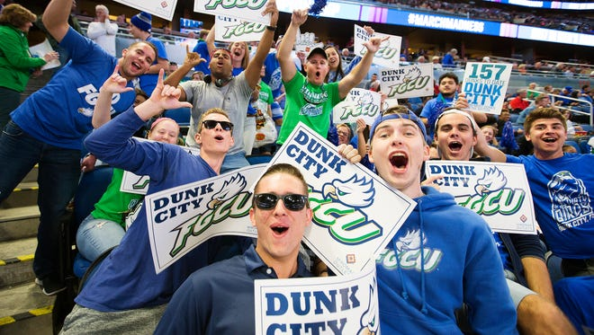 FGCU fans go wild for the Eagles before the start of FGCU's game Thursday against Florida State University in the NCAA Men's Division I Basketball Tournament at the Amyway Center in Orlando.