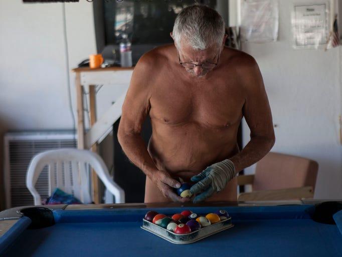 Ken Runo, 65, plays a game of pool at Shangri La Ranch.