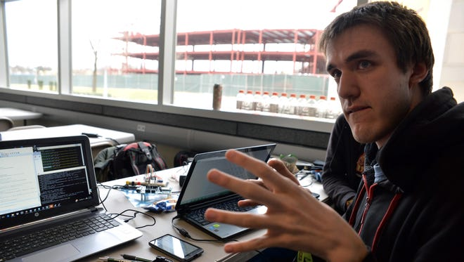 Hacker Michael Paule, 20, of Absecon, talks about his team's smart building project during the hackathon at Rowan University, Sunday, Mar. 13, 2016 inside Rowan Hall in Glassboro.