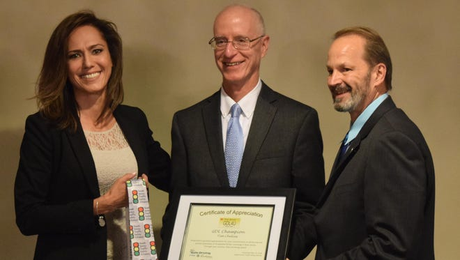 Tim Chelius (center), retired executive director of the South Jersey Transportation Planning Organization, receives the 2016 GDL Champion Award from Violet Marrero (left), consumer safety administrator at NJM Insurance Group, and Arnold Anderson, a founding member of the New Jersey Teen Safe Driving Coalition.