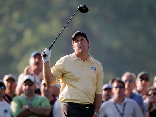 FILE - In this June 18, 2006, file photo, Phil Mickelson reacts to an errant drive on the 18th hole during the final round of the U.S. Open golf championship at Winged Foot Golf Club in Mamaroneck, N.Y. Jim Mahoney, who collected Mickelson's broken tee from 18 in 2006,  approached Mickelson's caddie during the pro-am at the Deutsche Bank Championship in September. He simply handed him an envelope that contained the broken tee and the letter. Mahoney parted with the tiny piece of U.S. Open history with hopes it could change Mickelson's luck in the tournament. (AP Photo/Morry Gash, File)