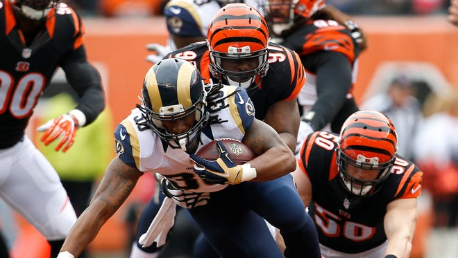 Cincinnati Bengals defensive tackle Geno Atkins (97) tackles St. Louis Rams running back Todd Gurley (30) for a loss in the first quarter during Week 12 NFL game between the St. Louis Rams and the Cincinnati Bengals, Sunday, Nov. 29, 2015, at Paul Brown Stadium in Cincinnati.