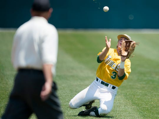 Edgewood Jackson Tate (3) catches a fly ball during the AISA Class AA State Baseball Championship Series Game 2 on Tuesday, May 5, 2015, at Paterson Field in Montgomery, Ala. Edgewood defeated Macon East 2-0 to tie the series at 1-1.
