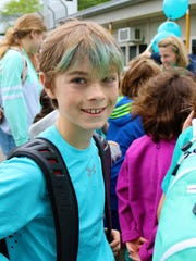 Washington School fourth-grader Blake Wotanowski sports teal hair to match his shirt during a Food Allergy Awareness Party on May 18, part of a week-long recognition of this important issue.