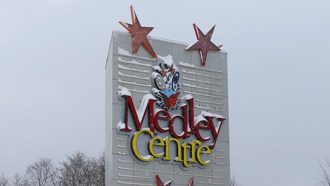 Snow covers the sign at the long vacant Medley Centre mall in Irondequoit Thursday, Jan. 21, 2016.