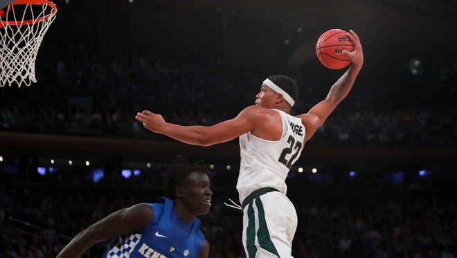 Michigan State Spartans forward Miles Bridges goes for a dunk in the second half of the State Farm Champions Classic at Madison Square Garden on Nov. 15, 2016 in New York City.