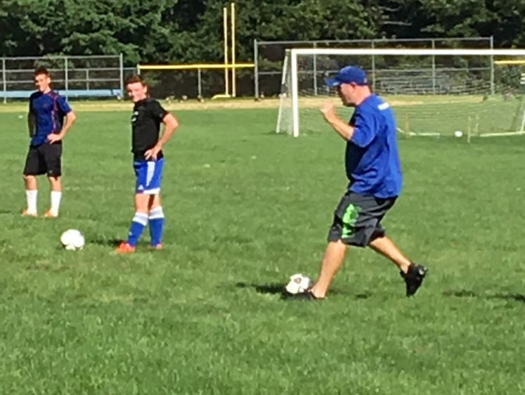 Pearl River coach Damon O'Keefe (left) participates in practice on Monday, Aug. 22, 2016.
