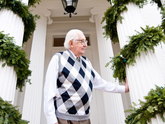 Tony Pomerleau, Burlington businessman and philanthropist, pauses on the porch of his downtown real estate office on Friday, December 3, 2010 — in advance of his annual Christmas party for 400 underprivileged kids and their parents