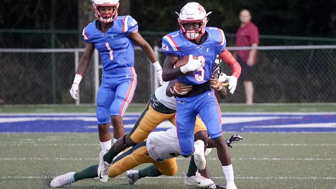 ACA wide receiver Kamari Lassiter (3) avoids tackle against Woodlawn at ACA on Friday, Aug. 30, 2019.