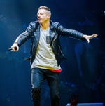 Macklemore performs during a concert at the Heineken Music Hall in Amsterdam, on September 18, 2013.