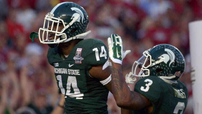 Michigan State receiver Tony Lippett (14) celebrates with teammate Macgarrett Kings Jr. (3) after a 25-yard touchdown reception in the third quarter of the 100th Rose Bowl against Stanford.