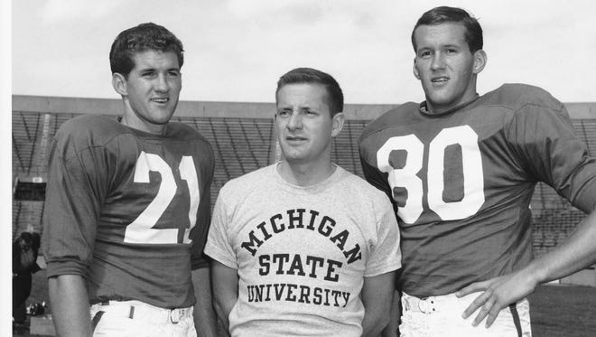 Dick Proebstle (21) and Jim Proebstle (80) with their high school coach, John McVay, an MSU assistant under coach Duffy Daugherty.