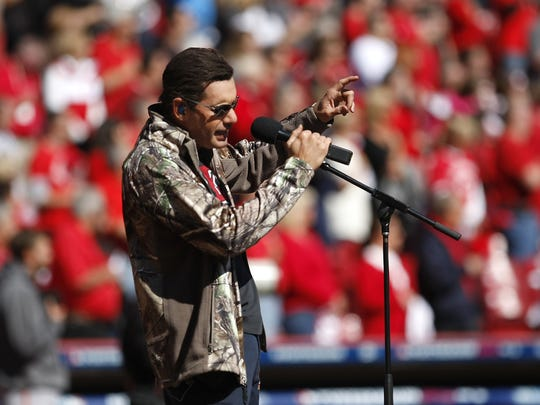 Country singer Rodney Atkins performs the National Anthem before a Cincinnati Reds game in 2012.