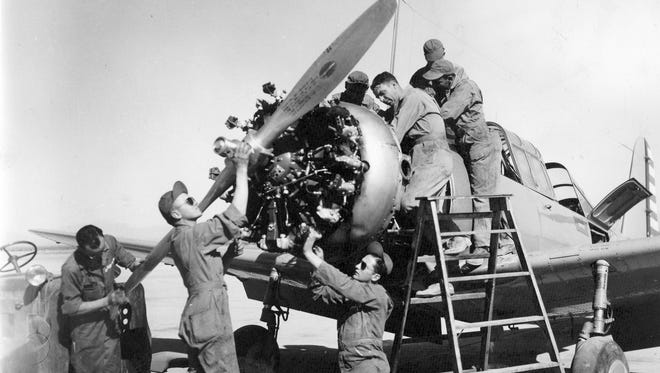 Mechanics work on aircraft at Williams Field during World War II. Republic