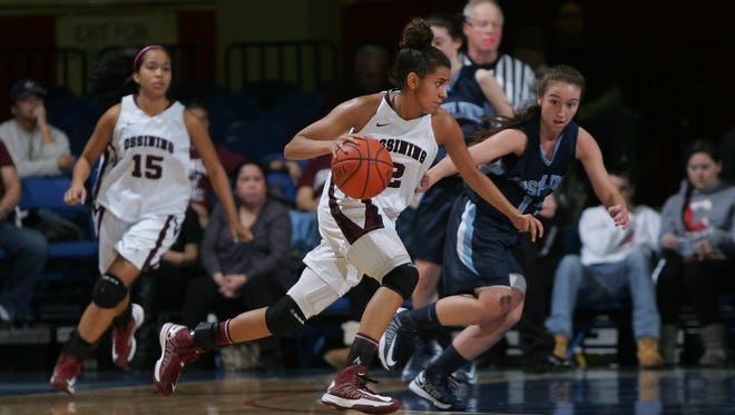 Ossining's Andrea Espinoza-Hunter (2) drives to the net as Ossining and Ursuline play the Girls Class AA Sectional semi-final basketball game on Feb. 28, 2013 at the Westchester County Center in White Plains.