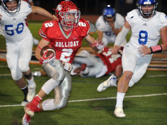 Holliday Eagles runningback Justin Jone (2) breaks