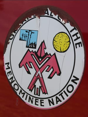 A battered seal of the Menominee Nation seen on the side of tribal pickup on the Menominee Indian Reservation in Keshena, Wis.